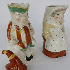 Pair of English Porcelain Punch and Judy Pitchers