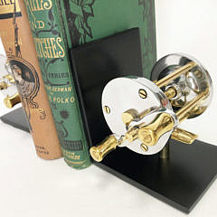Pair of Polished Chrome and Brass Fishing Reel Bookends