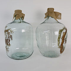 Pair of French Glass Wine Jugs, 20th c.