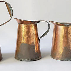 Set of 4 Antique Copper Graduated Pitchers